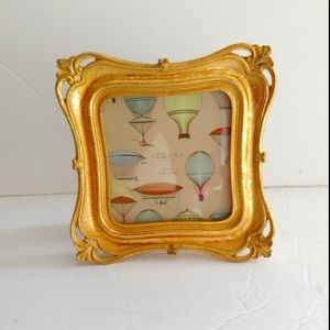 Azzure Home. Golden picture frame.
